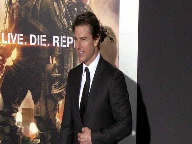 Tom Cruise Beams At Photographers At The 'Edge Of Tomorrow' NY Premiere