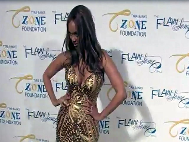 Tyra Banks Wears Gorgeous Gold At The 2014 Flawsome Ball