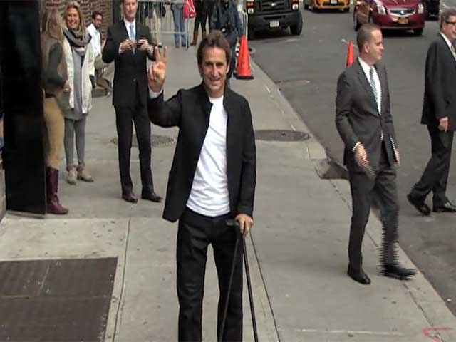 Racing Champ Alex Zanardi Waves At Photographers Outside 'Letterman'