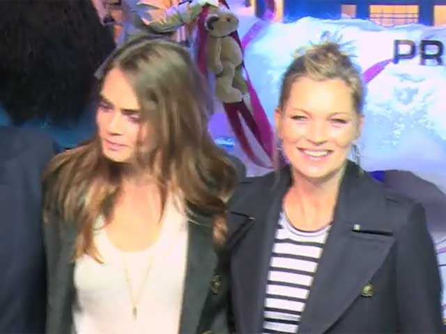 Cara Delevingne Wishes Paris A 'Joyeux Noel' With Kate Moss At Printemps