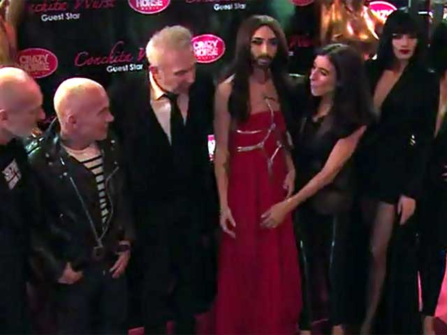 Conchita Wurst Poses With Cabaret Troupe At The Crazy Horse Saloon