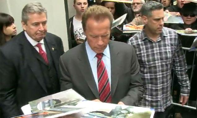 Arnold Schwarzenegger Greets Fans Outside New York Apple Store
