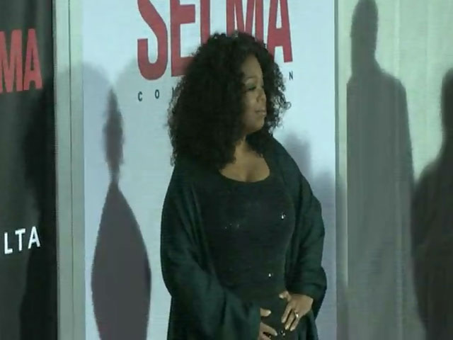 Oprah Winfrey Poses On The Red Carpet For The New York Premier Of 'Selma' - Part 3