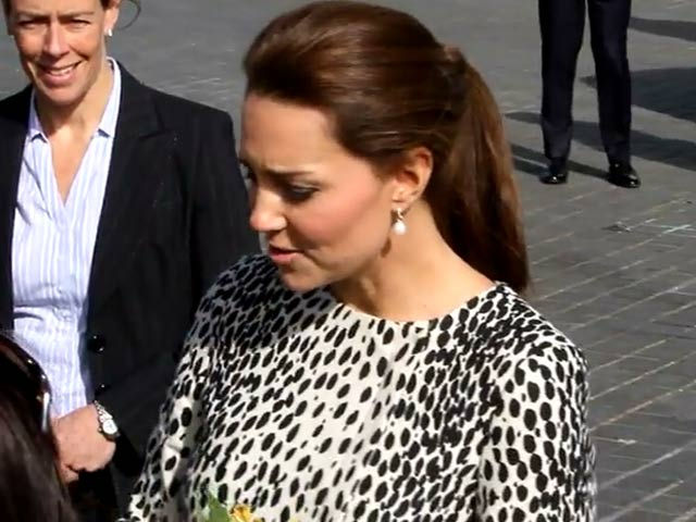 Catherine, Duchess Of Cambridge Accepts Flowers From Fans At Art Exhibition - Part 2